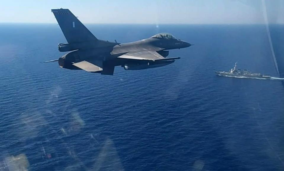 In this photo provided by the Greek Defense Ministry, a Greek air force jet takes part in a Greek-US military exercise south of the island of Crete, Monday, Aug. 24, 2020. Turkey is accusing France of stoking tensions in the eastern Mediterranean, where NATO allies Turkey and Greece are locked in a stiff standoff over competing claims over offshore energy exploration rights. The accusation came as European Union foreign ministers are set to meet on Thursday, Aug. 27, 2020 to persuade the two to pull back from the brink of a conflict. (Greek Defense Ministry via AP)