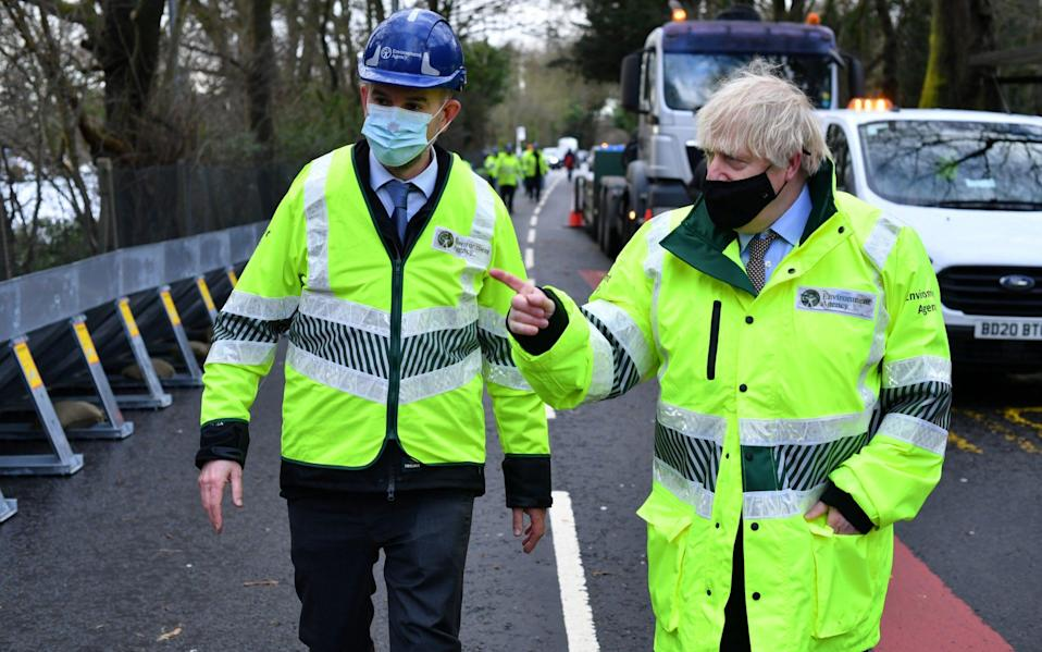 Britain's Prime Minister Boris Johnson visits Manchester as Storm Christoph brings heavy rains and flooding across the country - Paul Ellis/Pool via Reuters