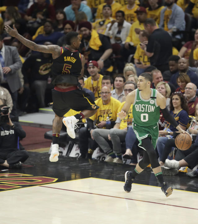 Cleveland Cavaliers' JR Smith (5) leaps as he defends against Boston Celtics' Jayson Tatum (0) in the second half of Game 3 of the NBA basketball Eastern Conference finals, Saturday, May 19, 2018, in Cleveland. (AP Photo/Tony Dejak)