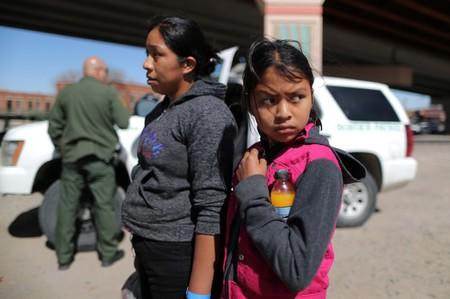 Guatemalan migrants Ismelda Cipriano, 31, and her daughter Petronila Cipriano, 12, wait to be processed after surrendering to U.S. Border Patrol Agents in El Paso
