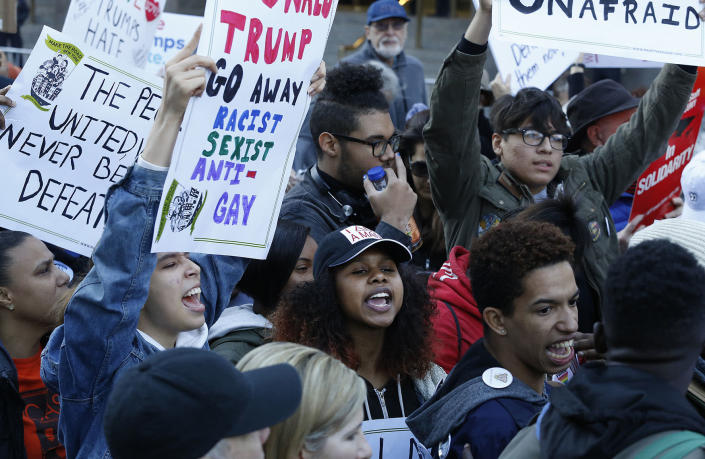 <p>Thousands of demonstrators protest the anticipated immigration policies of president-elect Donald Trump during a march, Sunday, Nov. 13, 2016 in New York. (AP Photo/Mark Lennihan) </p>