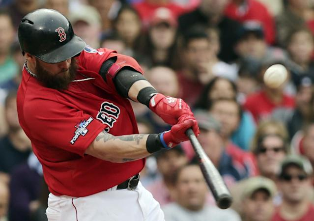 Boston Red Sox left fielder Jonny Gomes hits a two-run double off Tampa Bay Rays starting pitcher Matt Moore in the fourth inning in Game 1 of baseball's American League division series, Friday, Oct. 4, 2013, in Boston. (AP Photo/Charles Krupa)