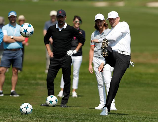 Golf - European Tour - BMW PGA Championship - Wentworth Club, Virginia Water, Britain - May 23, 2018 Former footballer Peter Schmeichel plays footgolf during the pro-am as England's Tommy Fleetwood and Manchester City manager Pep Guardiola look on Action Images via Reuters/Paul Childs