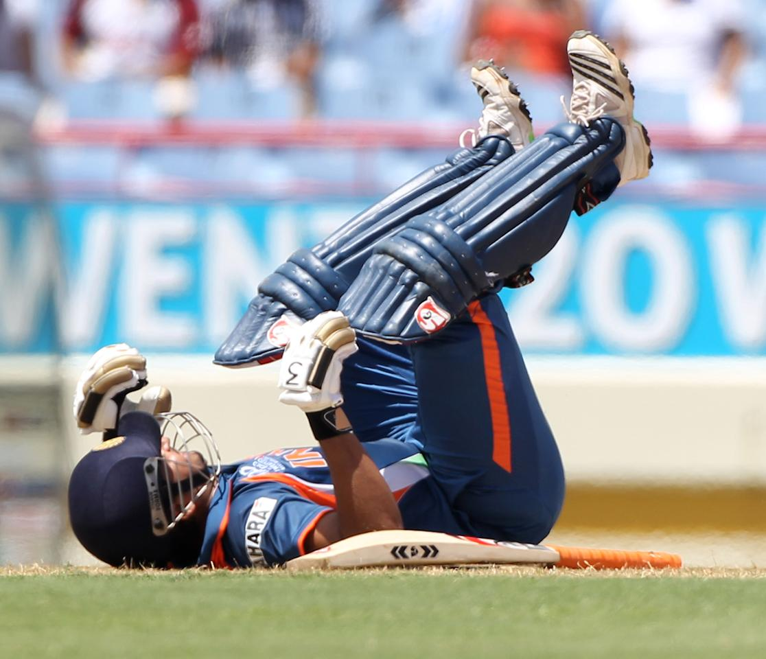 GROS ISLET, SAINT LUCIA - MAY 02:  Suresh Raina of India slips over durring The ICC World Twenty20 Group C match between South Africa and India played at The Beausejour Cricket Ground on May 2, 2010 in Gros Islet, Saint Lucia.  (Photo by Julian Herbert/Getty Images)