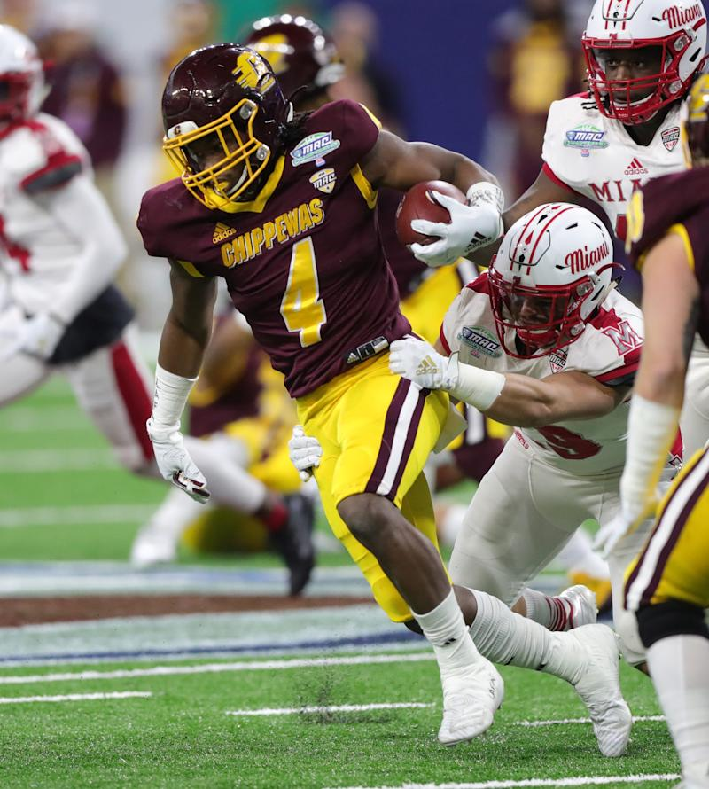CMU's Kobe Lewis is tackled by Miami's Matthew Salopek during the 2019 MAC championship game.