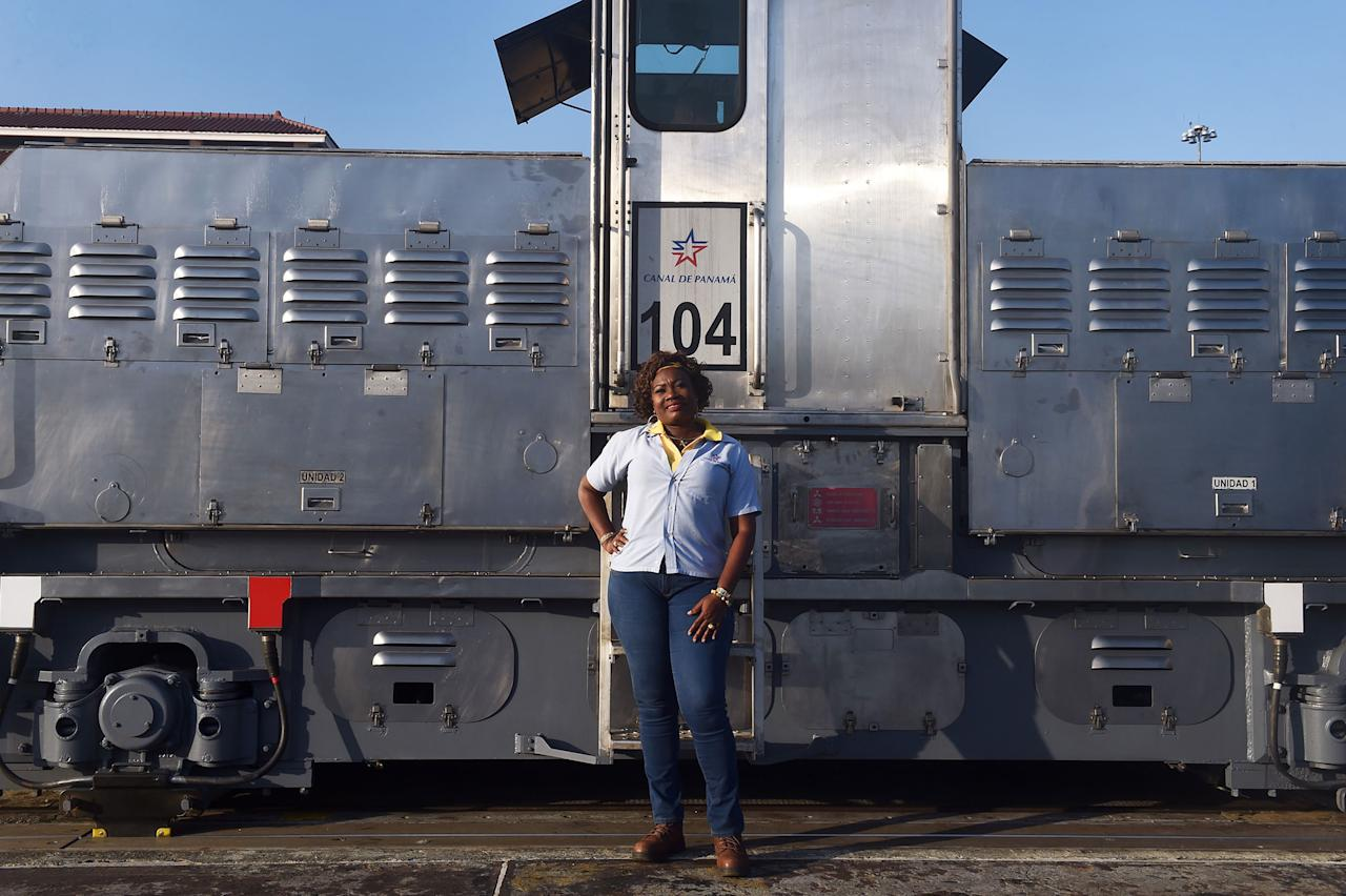 "<p>Locomotive, or ""mule,"" operator Glaciela Shreeves, 53, poses for pictures at the Panama Canal's Pedro Miguel Locks, where she works towing ships through the locks, on the outskirts of Panama City on February 22, 2018. (Photo: Rodrigo Arangua/AFP/Getty Images) </p>"