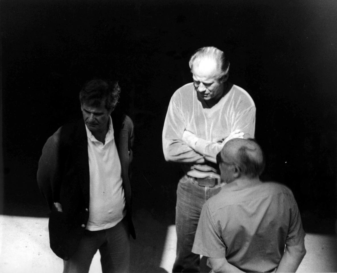 """This 1980 black and white surveillance photo released by the U.S. Attorney's Office and presented as evidence during the first day of a trial for James """"Whitey"""" Bulger in U.S. District Court in Boston, Wednesday, June 12, 2013, shows Bulger, center, with Ted Berenson, left, and Phil Wagenheim at a Lancaster Street garage in Boston's North End. Bulger is on trial for a long list of crimes, including extortion and playing a role in 19 killings. (AP Photo/U.S. Attorney's Office)"""