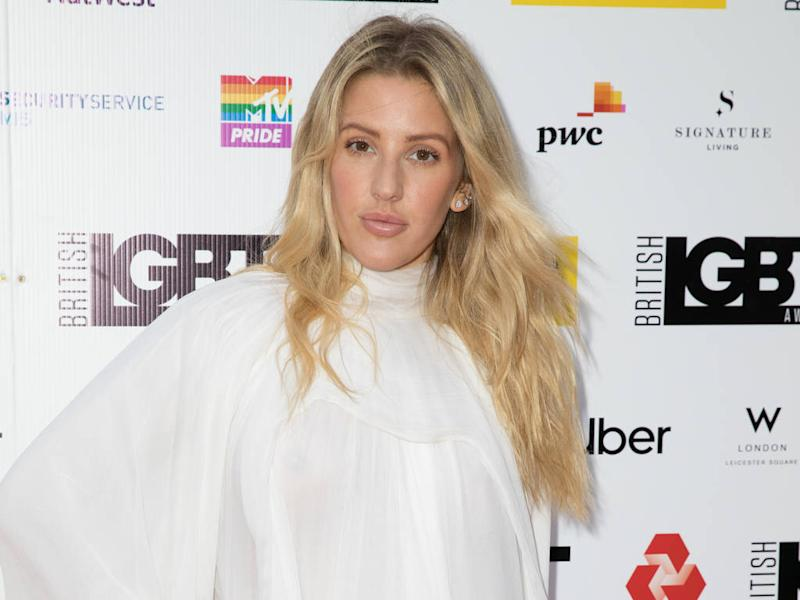 Ellie Goulding comes to rescue of driver in car pushed down the road by mail truck