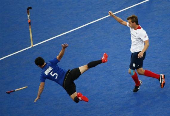 Argentina's Pedro Ibarra (L) flies through the air after clattering into Britain's Matthew Daly during their men's Group A hockey match at the London 2012 Olympic Games at the Riverbank Arena on the Olympic Park in London July 30, 2012.