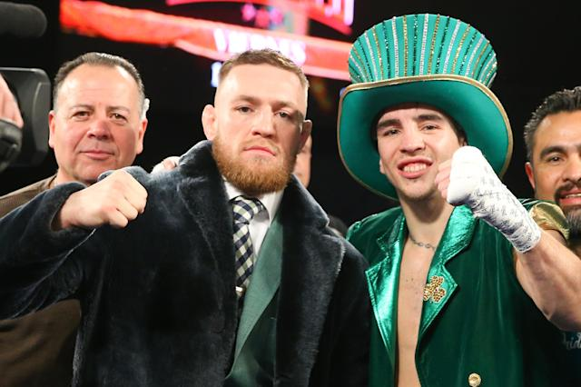 Conor McGregor and Michael Conlan celebrate Conlan's TKO win over Tim Ibarra after a super bantamweight bout at The Theater at Madison Square Garden on March 17, 2017, in New York. (Getty Images)