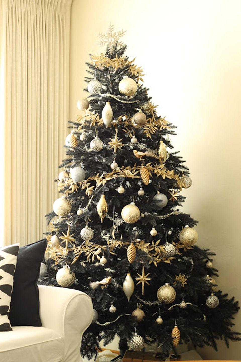 "<p>A black tree doesn't have to be rebellious and dark. It can also be festive, charming, and unique—this tree by <a href=""https://www.copycatchic.com/2013/11/copy-cat-chic-giveaway-treetopia.html"" rel=""nofollow noopener"" target=""_blank"" data-ylk=""slk:Copy Cat Chic"" class=""link rapid-noclick-resp"">Copy Cat Chic</a> is proof. </p>"