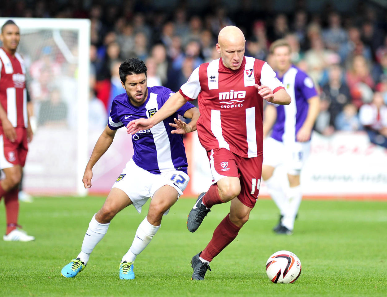 Cheltenham's Matt Richards and Oxford's Danny Rose in action during the Sky Bet League Two match at the Abbey Business Stadium, Cheltenham.