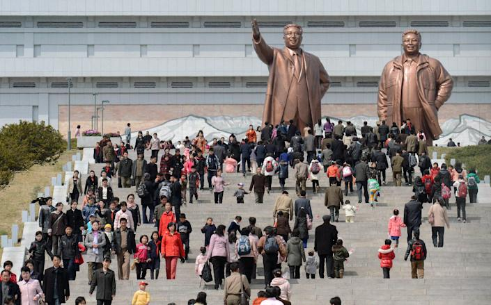 People visit giant statues of the late North Korean leaders, Kim Il Sung, left, and his son Kim Jong Il, in Pyongyang, North Korea, Monday, April 15, 2013. Oblivious to international tensions over a possible North Korean missile launch, Pyongyang residents spilled into the streets Monday to celebrate a major national holiday, the birthday of their first leader, Kim Il Sung. (AP Photo/Kyodo News)