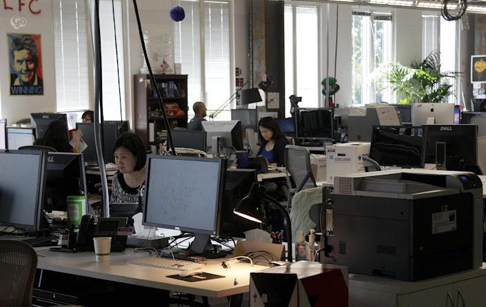 This May 11, 2012, photo shows workers at the Facebook office in Menlo Park, Calif. The company Mark Zuckerberg created as a Harvard student eight years ago is preparing for what looks to be the biggest Internet IPO ever. (AP Photo/Jeff Chiu)