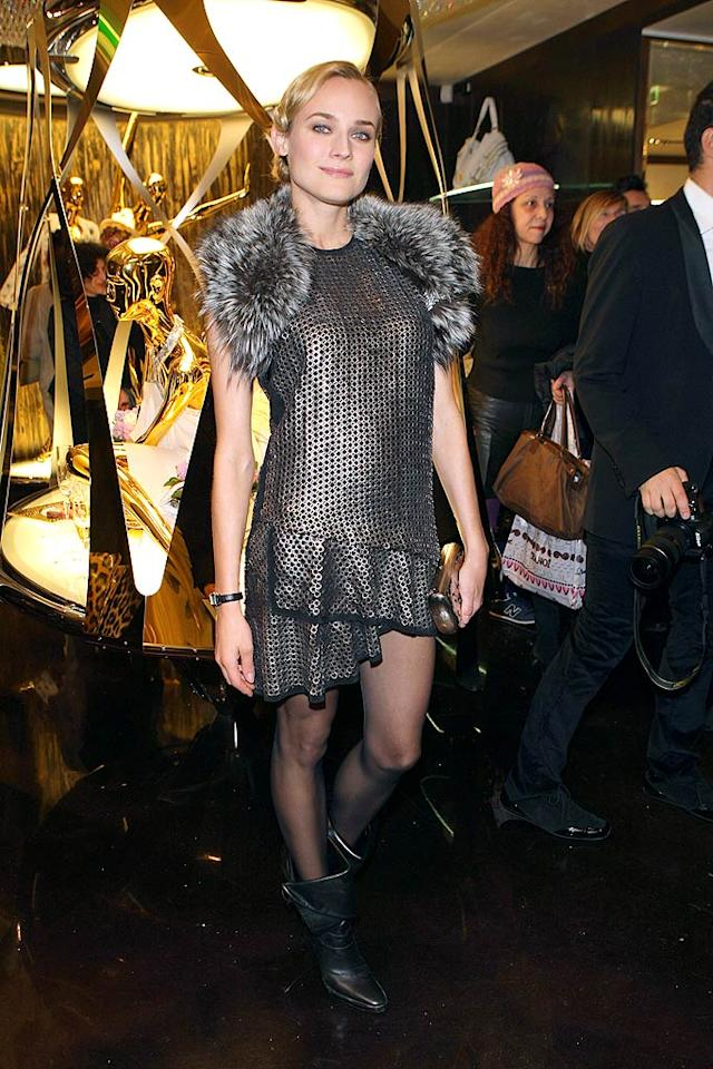 "Diane Kruger looked like a post-apocalyptic figure skater in a repulsive Roberto Cavalli chain-mail ""dress"" and fur shrug at the designer's boutique opening in Paris. Venturelli/<a href=""http://www.wireimage.com"" target=""new"">WireImage.com</a> - March 7, 2009"