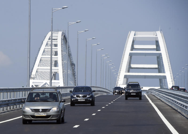 A view of the new bridge across the Kerch Strait linking Russia's Taman Peninsula with Crimea, after regular traffic began, in Kerch, Crimea, Wednesday, May 16, 2018. The 19-kilometer (11.8-mile) bridge, which took two years to build and cost $3.6 billion is Putin's project to show that Crimea has joined Russia for good. (AP Photo)