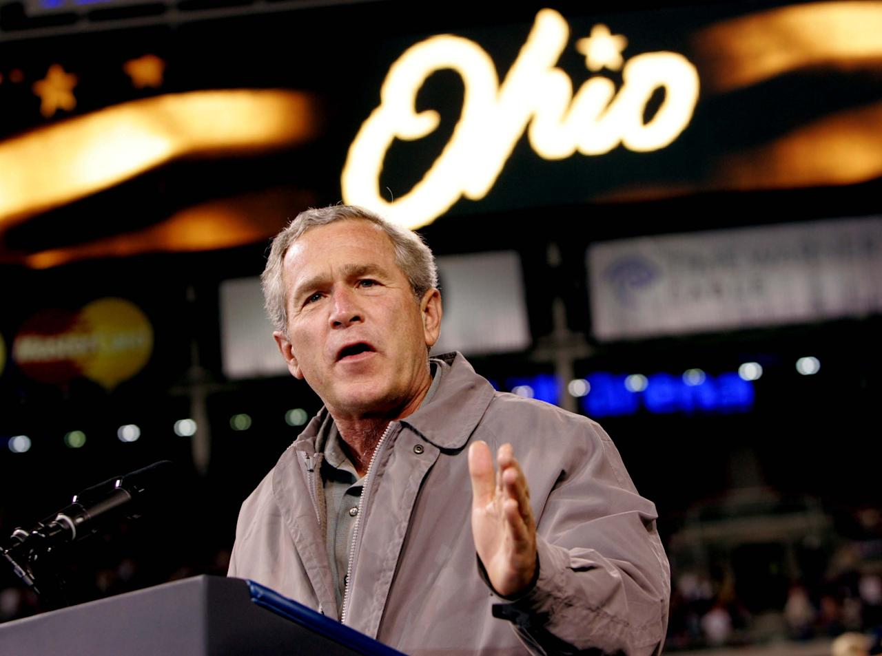 FILE - This Oct. 31, 2004 file photo shows President George W. Bush speaking to supporters at a campaign rally at the Great American Ball Park, in Cincinnati. Ohio is the presidential race's undisputed epicenter, and it's tilting toward Barack Obama. The revival of the local economy and the popularity of Obama's auto industry bailout are hampering Mitt Romney's call for Ohioans to return to the GOP-leaning ways that were crucial to George W. Bush. (AP Photo/Pablo Martinez Monsivais, File)