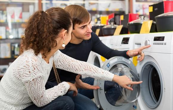 Couple looking at appliances