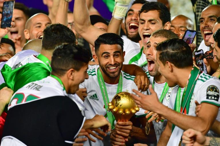 Captain Riyad Mahrez (C) holds the Africa Cup of Nations trophy after Algeria defeated Senegal in the 2019 final in Cairo.
