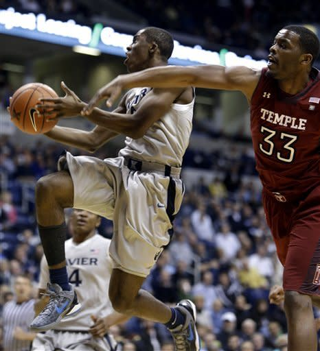 Xavier guard Semaj Christon (0) drives past Temple guard Scootie Randall (33) during the first half of an NCAA college basketball game, Thursday, Jan. 10, 2013, in Cincinnati. (AP Photo/Al Behrman)