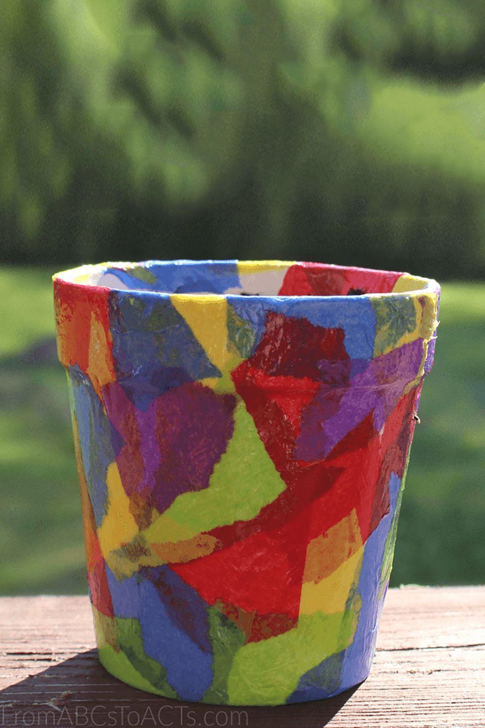 """<p>Have the kiddos help with tearing up tissue paper and glueing the pieces onto a flower pot. They'll love getting their hands dirty with this colorful craft!</p><p><strong>Get the tutorial at <a href=""""http://fromabcstoacts.com/tissue-paper-flower-pot"""" rel=""""nofollow noopener"""" target=""""_blank"""" data-ylk=""""slk:From ABCs To ACTs"""" class=""""link rapid-noclick-resp"""">From ABCs To ACTs</a>. </strong></p>"""