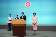 Hong Kong Chief Executive Carrie Lam, right, attends a news conference where she announces appointment of John Lee, second left, as the Chief Secretary, Chris Tang, second right, as the Secretary for Security and Raymond Siu as the Commissioner of Police in Hong Kong, Friday, June 25, 2021. China on Friday promoted Hong Kong's top security official to the territory's No. 2 spot as Beijing continues to clamp down on free speech and political opposition. (AP Photo/Kin Cheung)