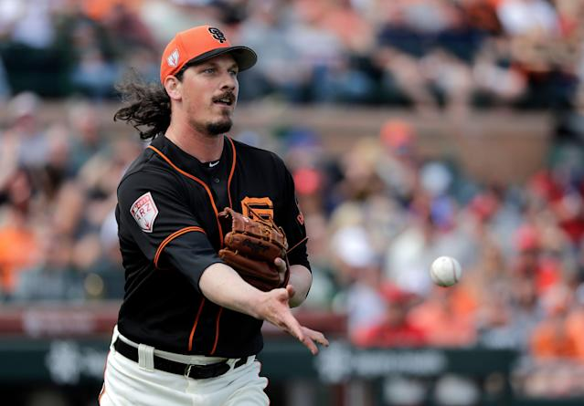 Giants pitcher Jeff Samardzija says MLB should get rid of extra innings and let games end in a tie. (AP Photo/Elaine Thompson)