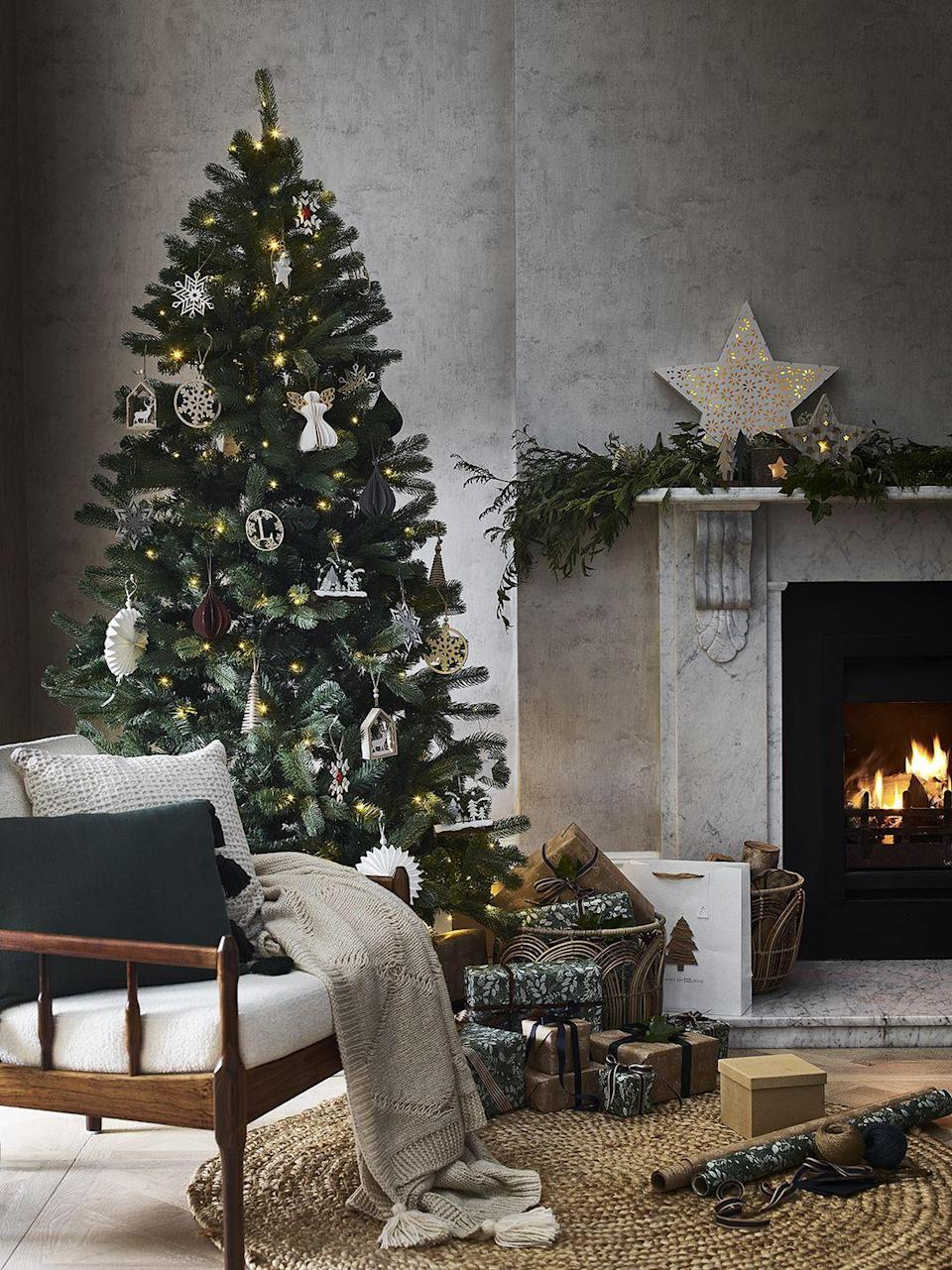 """<p>From dressing the <a href=""""https://www.housebeautiful.com/uk/garden/plants/g33917767/letterbox-christmas-tree/"""" rel=""""nofollow noopener"""" target=""""_blank"""" data-ylk=""""slk:tree"""" class=""""link rapid-noclick-resp"""">tree</a> to jazzing up the fireplace, there are heaps of ways to up the level of cosy in your home at Christmas. As part of George Home's 'Kindred' trend, discover stylish cushions, star string lights and gorgeous baubles. With the nights drawing in, we couldn't think of anything better than curling up in the <a href=""""https://www.housebeautiful.com/uk/decorate/living-room/g30980928/small-living-room-ideas/"""" rel=""""nofollow noopener"""" target=""""_blank"""" data-ylk=""""slk:living room"""" class=""""link rapid-noclick-resp"""">living room</a>...</p>"""