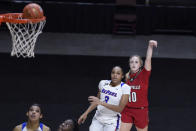 Louisville's Hailey Van Lith (10) watches her 3-point basket go in, next to DePaul's Deja Church (3) during the second half of an NCAA college basketball game Friday, Dec. 4, 2020, in Uncasville, Conn. (AP Photo/Jessica Hill)