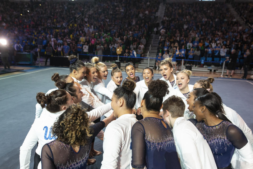 LOS ANGELES, CA - FEBRUARY 16: The UCLA women's gymnastics team cheers before competing against Arizona State University at Pauley Pavilion on Saturday, February 16, 2019. (Allison Zaucha for The Washington Post via Getty Images)