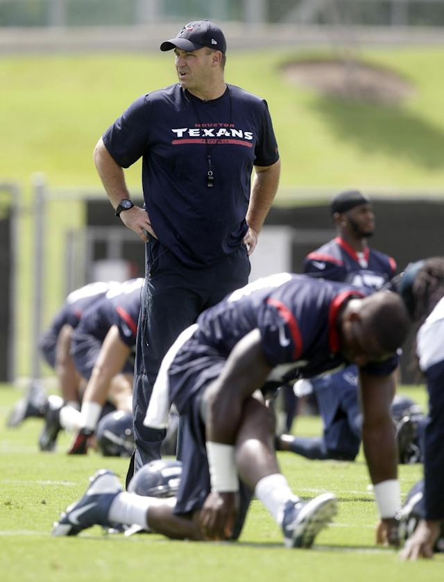 FILE - In this June 17, 2014, file photo, Houston Texans head coach Bill O'Brien walks through practice during NFL football minicamp in Houston. (AP Photo/Patric Schneider, File)