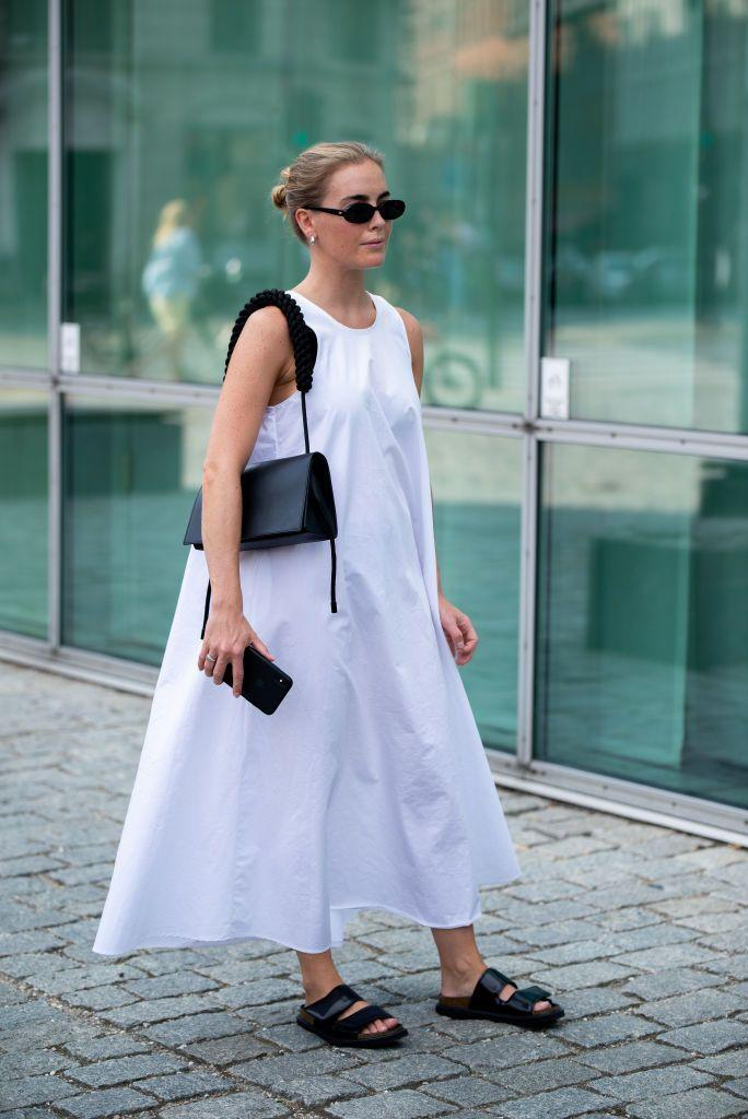 <p>Summer isn't over yet. Translation: The white cotton dress is still in. But even come early fall, just swap your sandals for boots to keep this breezy number in the mix. </p>