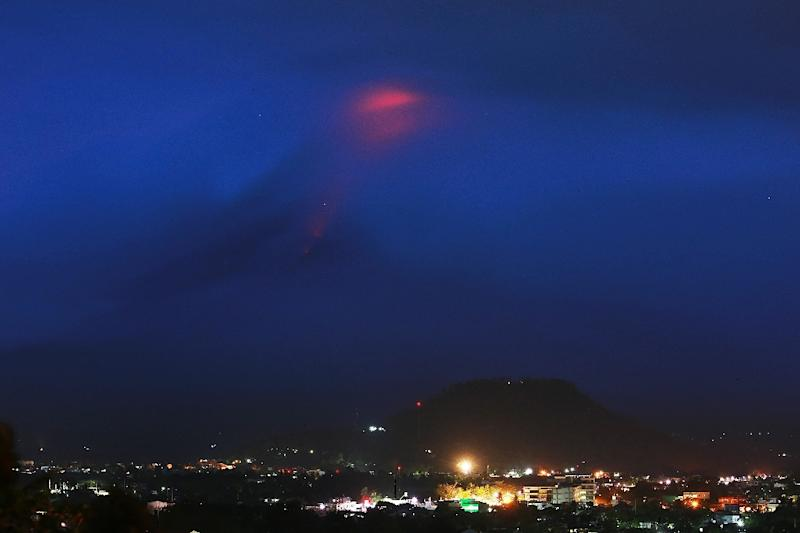 12,000 people have left their homes after scientists warned that the perfect cone of Mayon could erupt in the coming hours or days (AFP Photo/Simvale SAYAT)