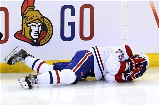 Montreal Canadiens' P.K Subban (76) covers his face after he was checked by the Ottawa Senators during the first period of Game 3 of their first-round NHL hockey Stanley Cup playoff series, Sunday, May 5, 2013, in Ottawa, Ontario. The Senators won 6-1. (AP Photo/The Canadian Press, Fred Chartrand)