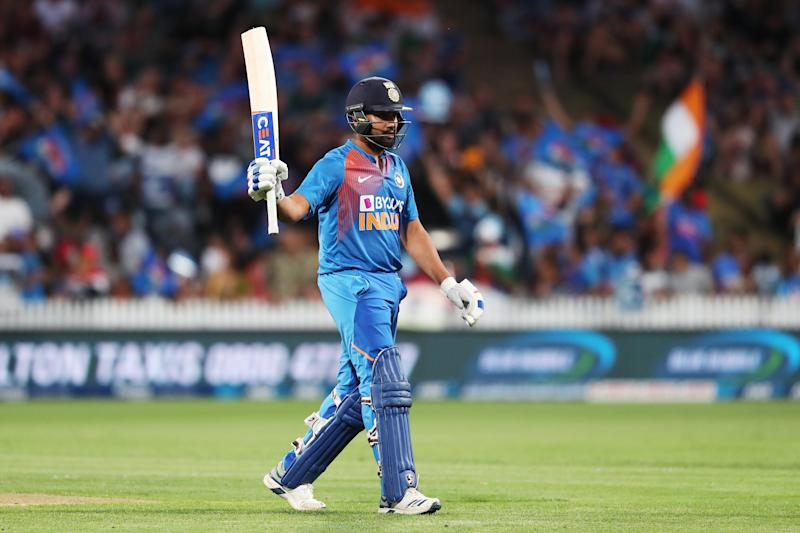 Rohit Sharma raises his bat and celebrates 50 runs during the third Twenty20 cricket match between New Zealand and India.