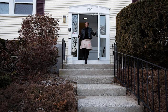 Mona Pompilus leaves her home to go for a walk in Foxborough. (Photo: Kayana Szymczak for Yahoo News)