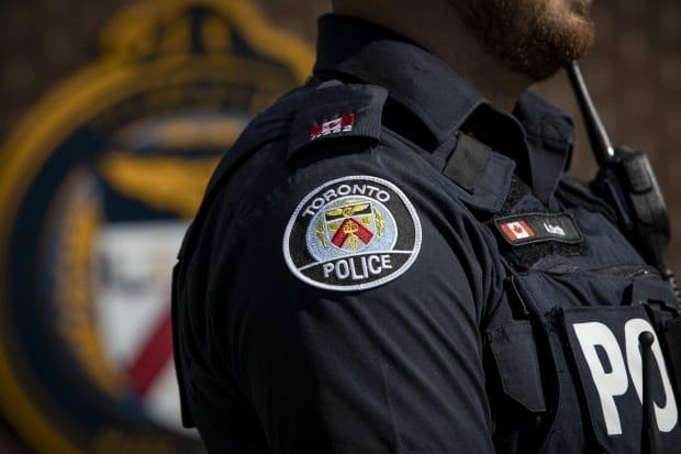 A Toronto police officer will be demoted from first-class constable to fourth class for a year for having inappropriate interactions with multiple female police cadets, a tribunal decided on Monday. (Evan Mitsui/CBC - image credit)