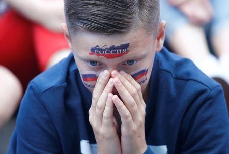 Soccer Football - World Cup - Group A - Uruguay vs Russia - St. Petersburg, Russia - June 25, 2018. A Russia's fan reacts as he watches the broadcast at the Saint Petersburg Fan Fest. REUTERS/Anton Vaganov