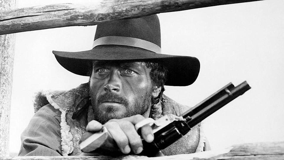 Franco Nero sports a cowboy hat and holds a pistol in a promotional image from the 1966 spaghetti western Massacre Time.