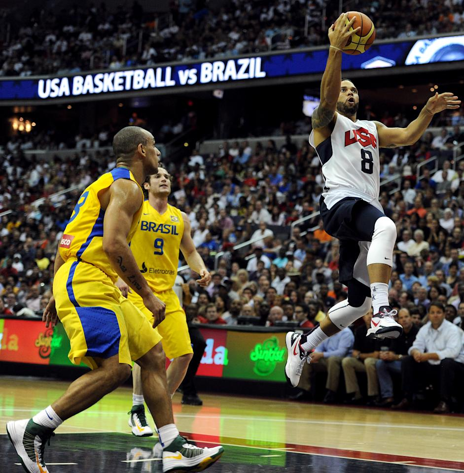 WASHINGTON, DC - JULY 16: Deron Williams #8 of the US Men's Senior National Team drives to the hoop past Brazil in the first quarter during a pre-Olympic exhibition basketball game at the Verizon Center on July 16, 2012 in Washington, DC. (Photo by Patrick Smith/Getty Images)