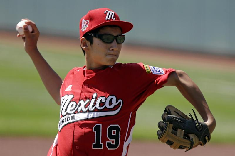 Tijuana, Mexico pitcher Luis Manzo delivers in the first inning of the International Championship baseball game against Tokyo, Japan at the Little League World Series tournament in South Williamsport, Pa., Saturday, Aug. 24, 2013. (AP Photo/Gene J. Puskar)