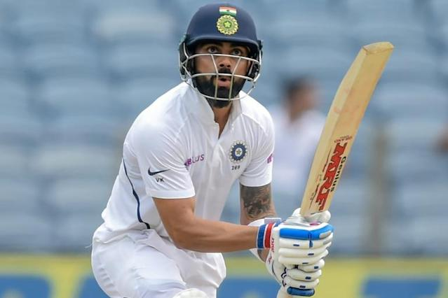 India's Virat Kohli registered his seventh Test century in the current series against a struggling South Africa (AFP Photo/PUNIT PARANJPE)