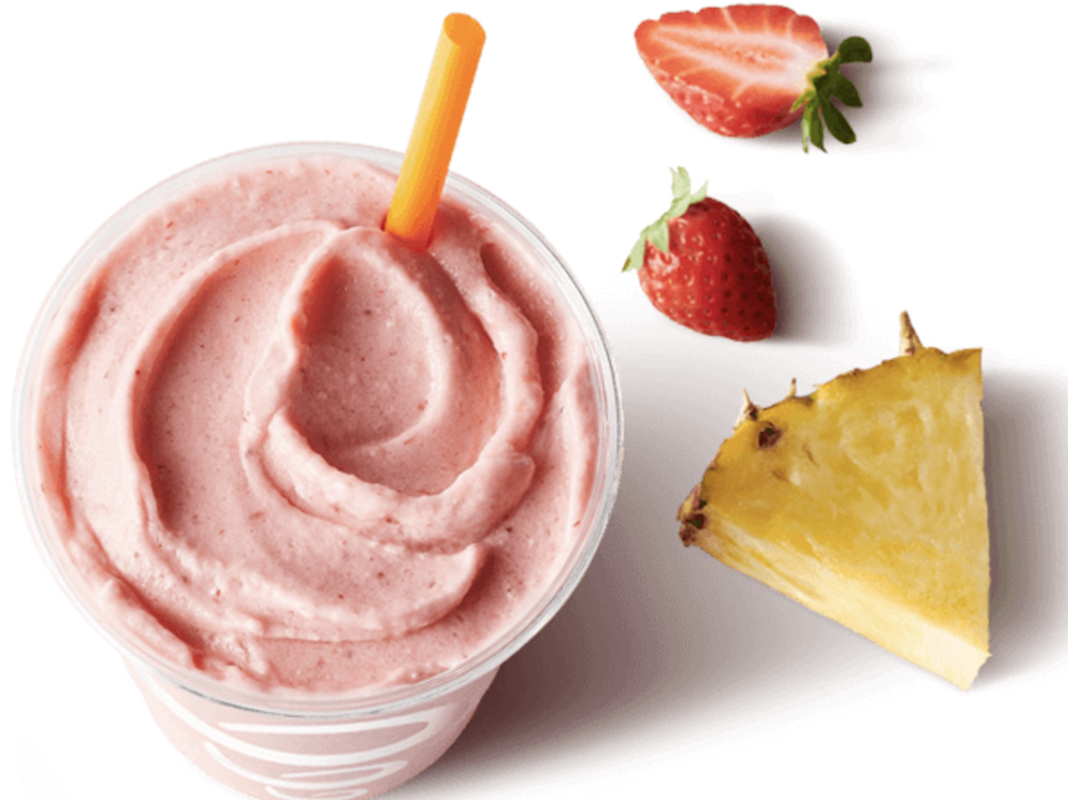 a smoothie made with pineapple and strawberry