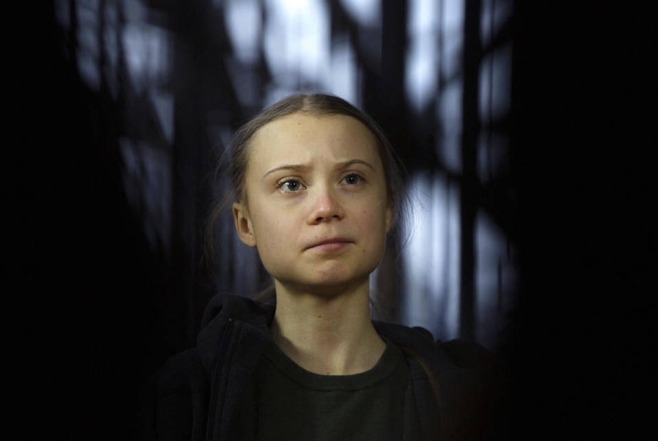 FILE - In this March 5, 2020 file photo, Swedish climate activist Greta Thunberg speaks with the media as she arrives for a meeting of the Environment Council at the European Council building in Brussels. On Friday, June 25, 2021, the Associated Press reported on stories circulating online incorrectly claiming a video shows Thunberg arguing that climate change isn't real. (AP Photo/Virginia Mayo, File)