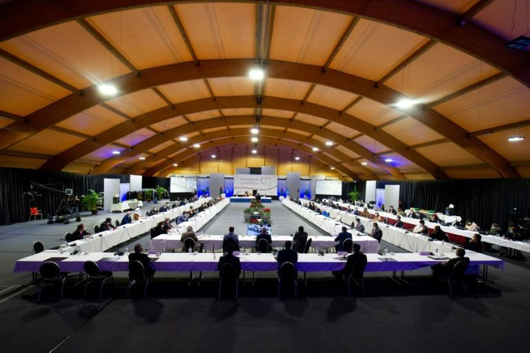Delegates attending a vote for the new interim government during a meeting of the Libyan Political Dialogue Forum near Geneva