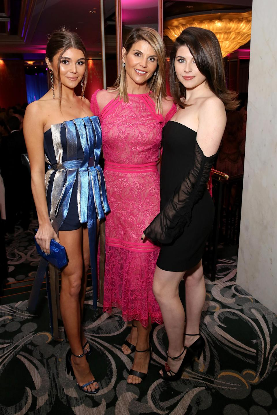 Lori Loughlin with daughters, Olivia Jade Giannulli and Isabella Rose Giannulli, on the red carpet in February. (Photo: Rachel Murray/Getty Images for WCRF)