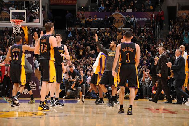 LOS ANGELES, CA - FEBRUARY 28: The Los Angeles Lakers celebrate their victory over the Sacramento Kings at Staples Center on February 28, 2014 in Los Angeles, California. (Photo by Evan Gole/NBAE via Getty Images)