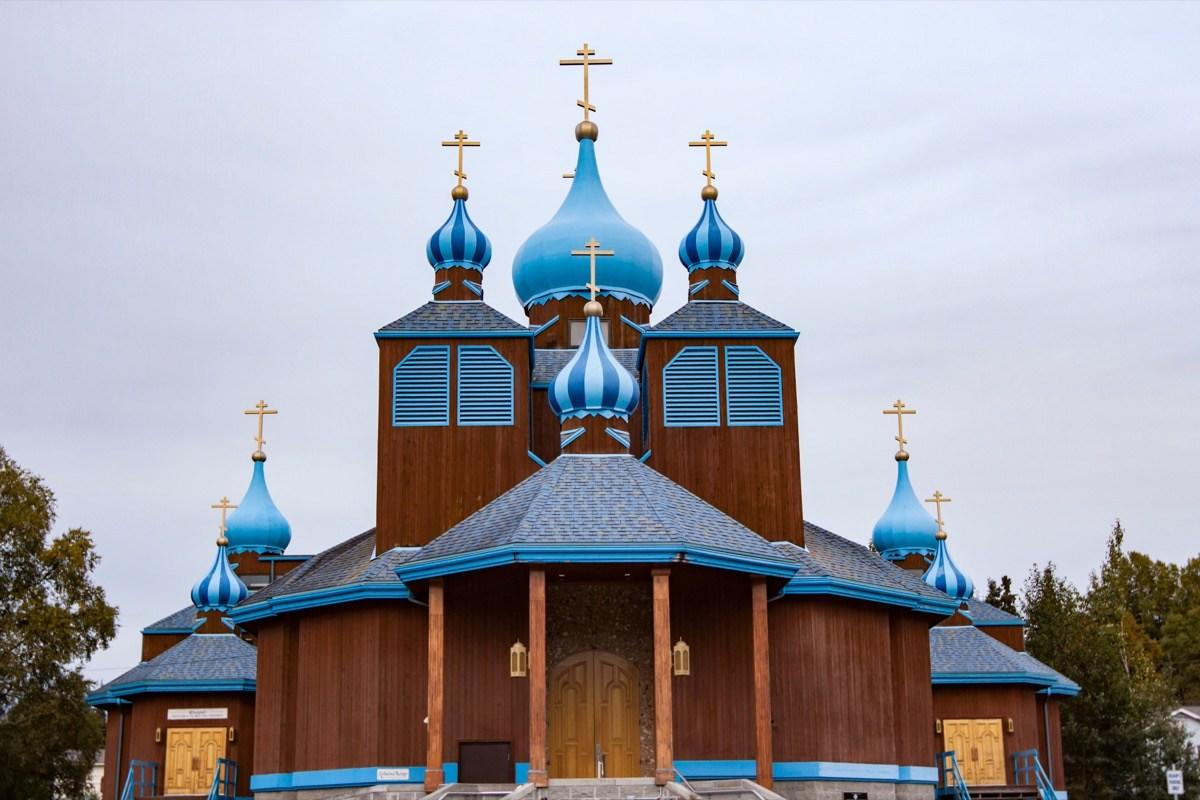 """Alaska has a robust Russian Orthodox community with their own Christmas traditions—most notably <a href=""""http://sitkahistory.com/2016/12/selaviq-a-russian-orthodox-christmas-tradition-in-alaska-2/"""" target=""""_blank""""><em>Selaviq</em></a>. It isn't unlike most Christmas celebrations, but this one takes place on Jan. 7 rather than <a href=""""https://bestlifeonline.com/christmas-jesus-birthday/?utm_source=yahoo-news&utm_medium=feed&utm_campaign=yahoo-feed"""" target=""""_blank"""">Dec. 25</a>, due to Russians using the old Julian calendar.  Following services in places like Sitka, Alaska, churchgoers form a procession led by a wooden star to symbolize the journey of the Three Kings who followed the Star of Bethlehem to Christ's birthplace. The procession also involves some of the same things that typical U.S. Christmas celebrations do: food, gifts, and hymns."""