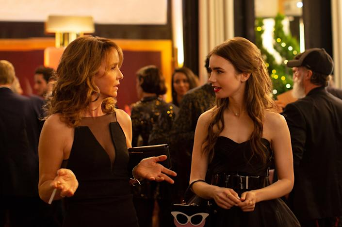 Philippine LeRoy-Beaulieu as Sylvie Grateau and Lily Collins as Emily Cooper in episode 102 of Emily in Paris