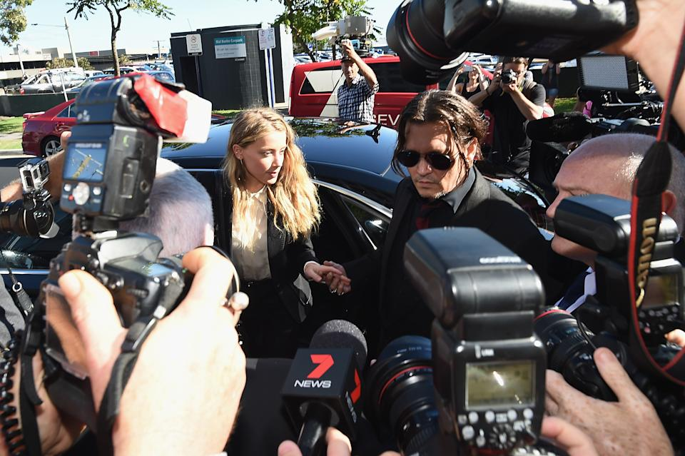 GOLD COAST, AUSTRALIA - APRIL 18:  Johnny Depp and Amber Heard arrives at Southport Magistrates Court on April 18, 2016 in Gold Coast, Australia. Heard is facing two counts of breaching Australia's quarantine laws by allegedly bringing in her pet dogs Pistol and Boo on a private jet in May 2015.  (Photo by Matt Roberts/Getty Images)